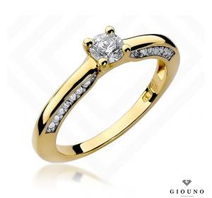 Złoty pierścionek z brylantem 0,44ct