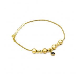 Bransoletka złota z kulkami i czarnym kamieniem