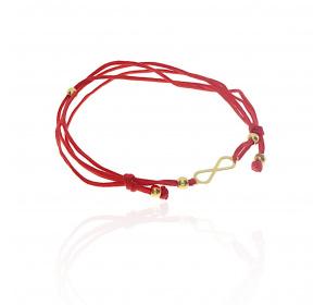 Złota bransoletka na czerwonym sznurku znak nieskończoności